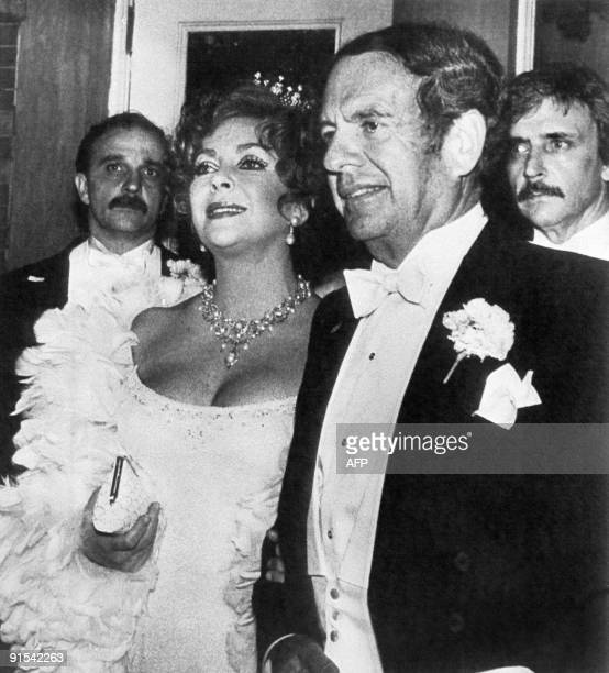Britishborn US actress Elizabeth Taylor and her current companion Victor Luna are flanked by bodyguards 08 May 1983 as they arrive at Tavern on the...