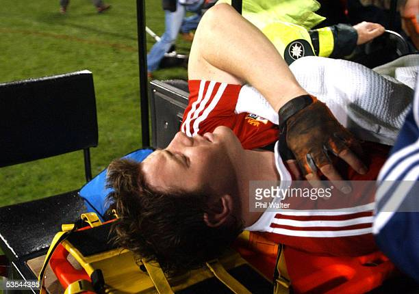 Britishg and Irish Lions captain Brian O'Driscoll leaves the field on a stretcher againnst the All Blacks during the first rugby union test in...