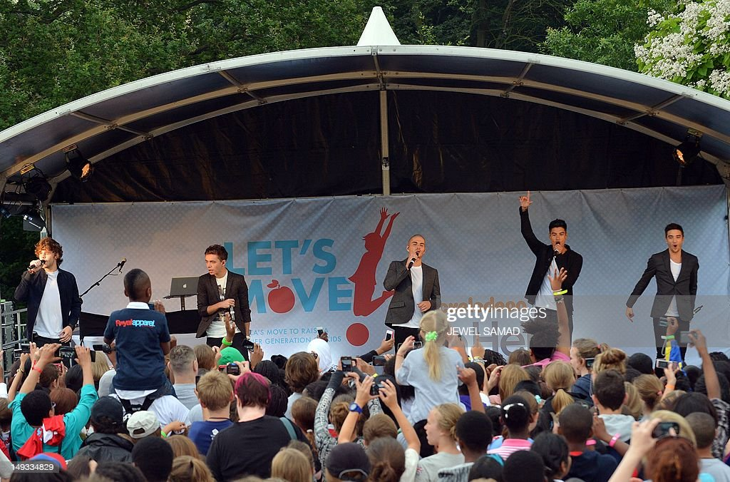 British-Irish boy band The Wanted perform on stage during US First Lady Michelle Obama's 'Let's Move-London' event at the Winfield House in London on July 27, 2012, hours before the start of the London 2012 Olympic Games. AFP PHOTO/Jewel Samad