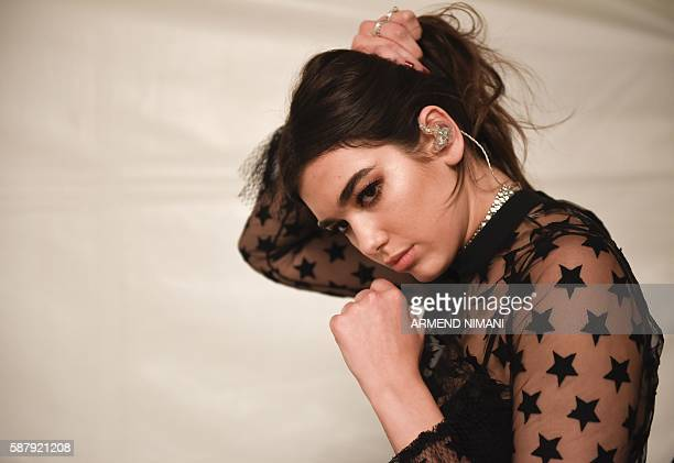 BritishKosovan singer Dua Lipa prepares in backstage prior to her first concert held in her hometown Pristina at the Germia National Park on August 9...