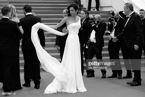 BritishLebanese lawyer Amal Clooney poses on May 12 2016 as she arrives for the screening of the film 'Money Monster' at the 69th Cannes Film...