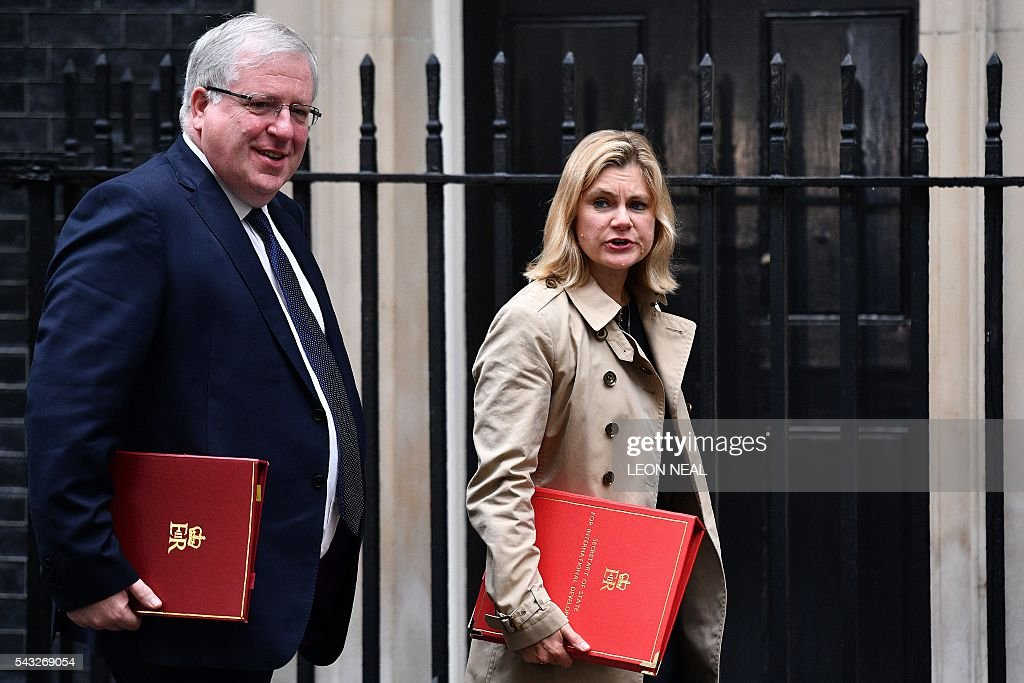 BritishTransport Secretary Patrick McLoughlin (L) and British International Development Secretary Justine Greeningust arrives to attend a cabinet meeting at 10 Downing Street in central London on June 27, 2016. Britain should only trigger Article 50 to leave the EU when it has a 'clear view' of how its future in the bloc looks, finance minister George Osborne said Monday following last week's shock referendum. London stocks sank more than 0.8 percent in opening deals on Monday, despite attempts by finance minister George Osborne to calm jitters after last week's shock Brexit vote. / AFP / LEON