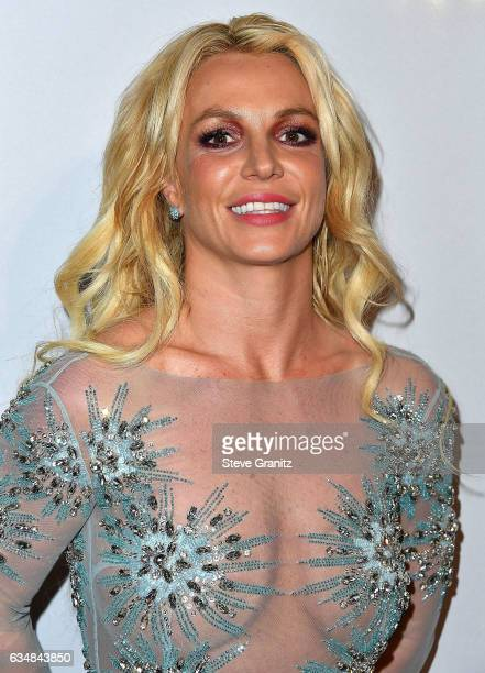 Britney Spears arrives at the PreGRAMMY Gala and Salute to Industry Icons Honoring Debra Lee on February 11 2017 in Los Angeles California