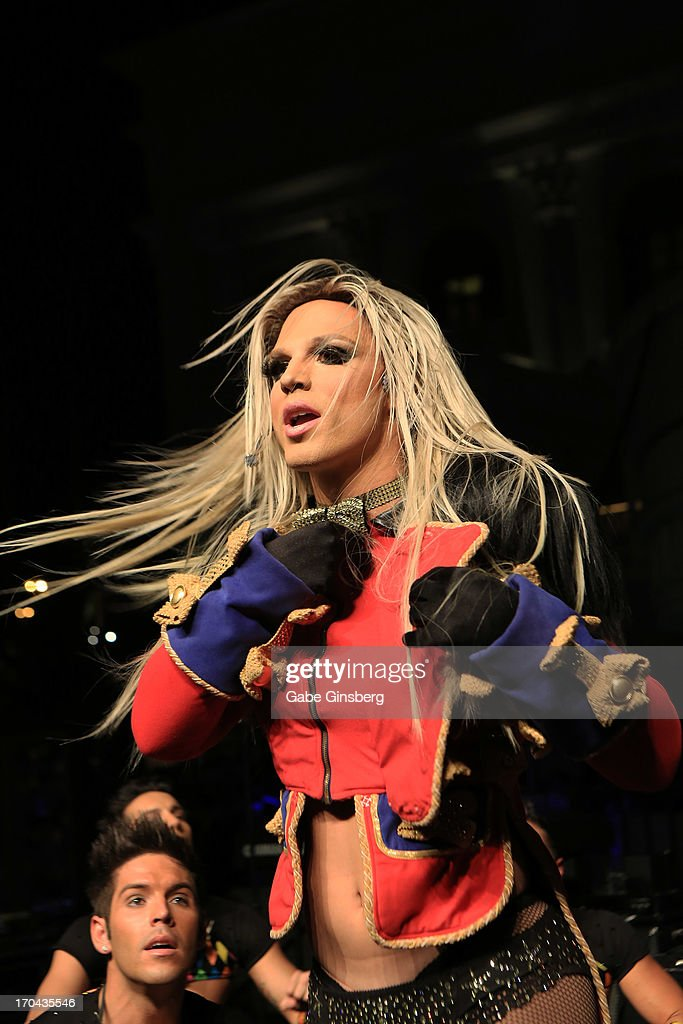 <a gi-track='captionPersonalityLinkClicked' href=/galleries/search?phrase=Britney+Spears&family=editorial&specificpeople=156415 ng-click='$event.stopPropagation()'>Britney Spears</a> impersonator Derrick Barry from the show 'Divas' performs at the closing night party for the U.S. Travel Association's International Pow Wow at the Garden of the Gods Pool at Caesars Palace on June 12, 2013 in Las Vegas, Nevada.