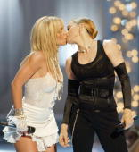 Britney Spears Madonna and Christina Aguilera perform onstage during the 2003 MTV Video Music Awards at Radio City Music Hall on August 28 2003 in...