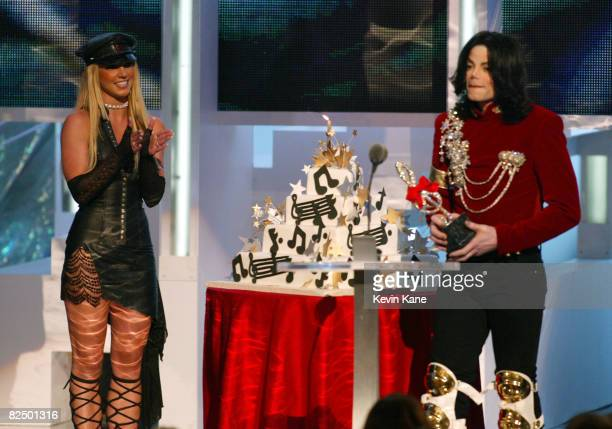 Britney Spears presents Michael Jackson a birthday cake at the 2002 MTV Video Music Awards