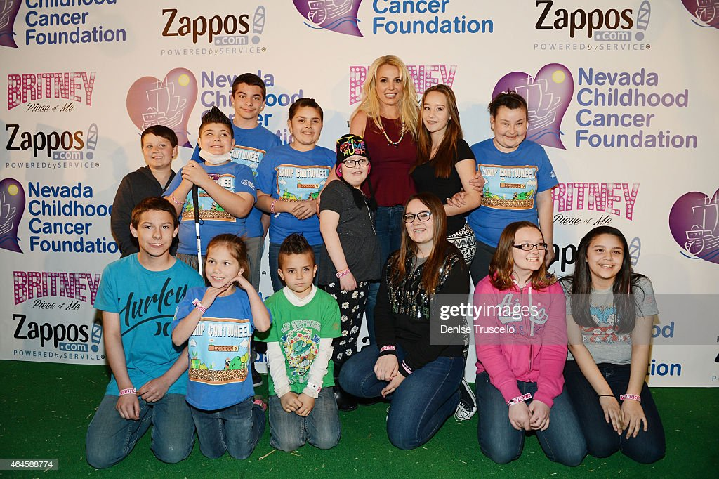 Britney Spears (C) visits the Zappos.com campus in Downtown Las Vegas to celebrate her partnership with the Nevada Childhood Cancer Foundation (NCCF) and Zappos on February 26, 2015 in Las Vegas, Nevada. Britney met with children and played with animals from the Roos-n-More Zoo. All funds raised are donated in support of the NCCF.