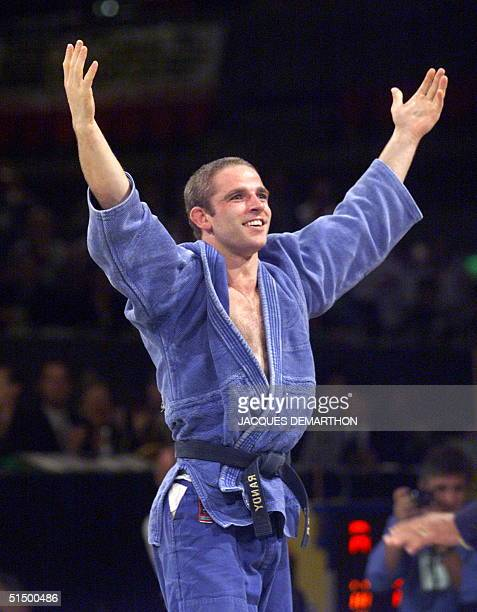 Briton Graeme Randall jubilates after winning the under81kilogram category final against Uzbek Farkhod Turaev in the 26th World Judo Championships in...