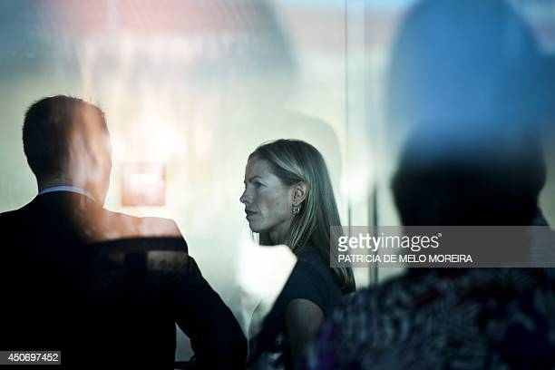 Britons Kate McCann and her husband Gerry McCann parents of missing British girl Madeleine McCann arrive to the court house in Lisbon on June 16 2014...