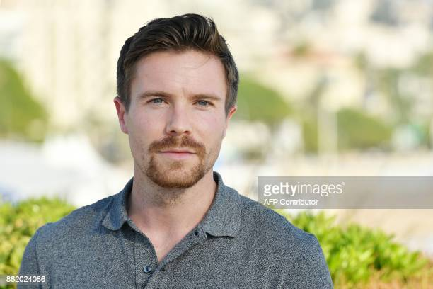 Britsh actor Joe Dempsie cast of the thriller tv series 'Deep state' poses for a photograph during the MIPCOM trade show in Cannes southern France on...