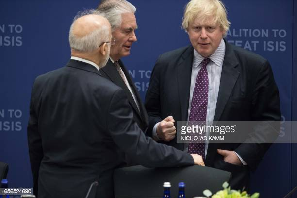 Britsh foreign Secretary Boris Johnson speaks with US Secretary of State Rex Tillerson and Iraqi Foreign Minister Ibrahim alJafari at a meeting of...