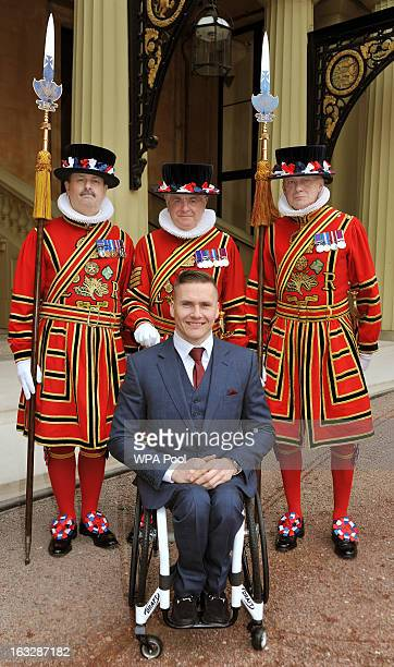 Britsish Paralympian and sixtimes Paralympic gold medalist David Weir arrives to a Guard of Honour at Buckingham Palace to receive The Most Excellent...