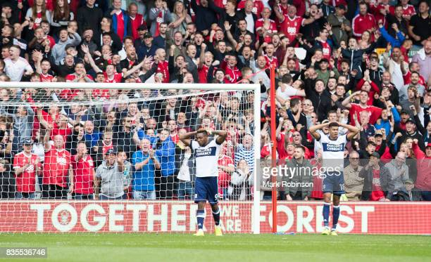 Britt Assombalonga and Rudy Gestede of Middlesbrough after a missed chance for their team during the Sky Bet Championship match between Nottingham...