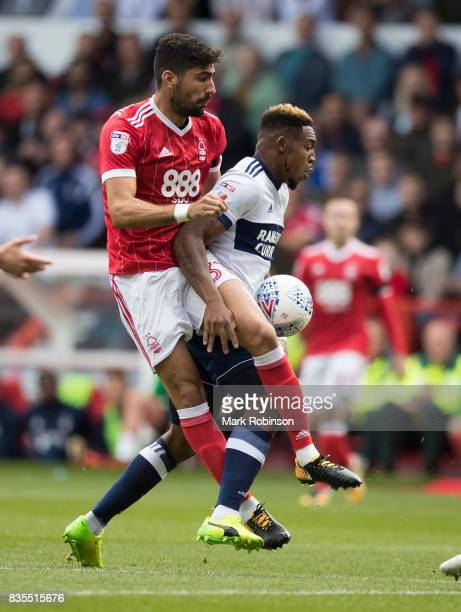 Britt Assombalonga of Middlesbrough and Andreas Bouchalakis of Nottingham Forest during the Sky Bet Championship match between Nottingham Forest and...