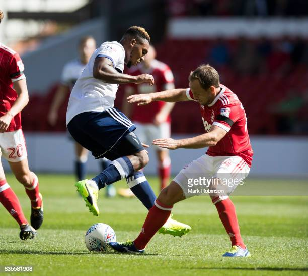 Britt Assombalonga of Middlesbrough and David Vaughan of Nottingham Forest during the Sky Bet Championship match between Nottingham Forest and...