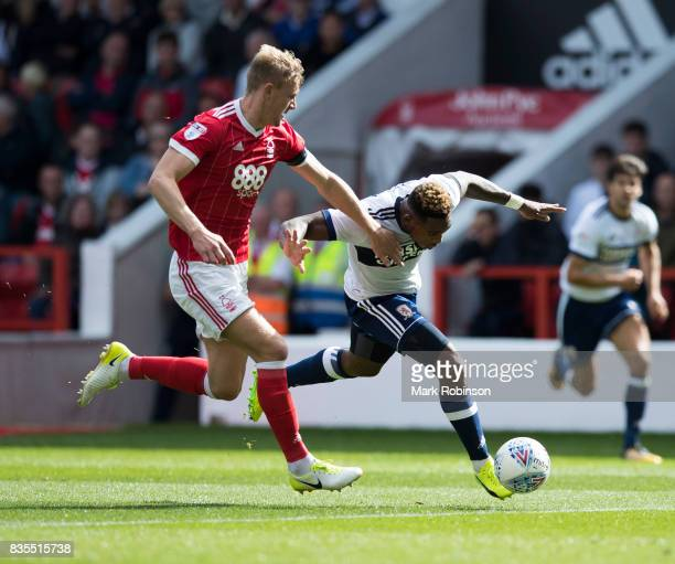 Britt Assombalonga of Middlesbrough and Joe Worrall of Nottingham Forest during the Sky Bet Championship match between Nottingham Forest and...