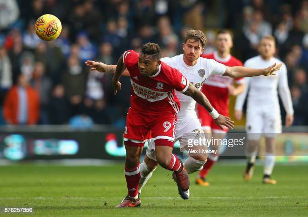 Britt Assombalonga of Middlesbrough beats Gaetano Berardi of Leeds United during the Sky Bet Championship match between Leeds United and...