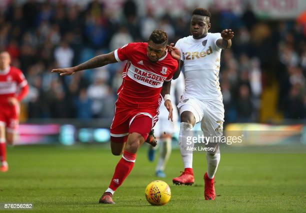 Britt Assombalonga of Middlesbrough holds off a challenge from Ronaldo Vieira of Leeds United during the Sky Bet Championship match between Leeds...