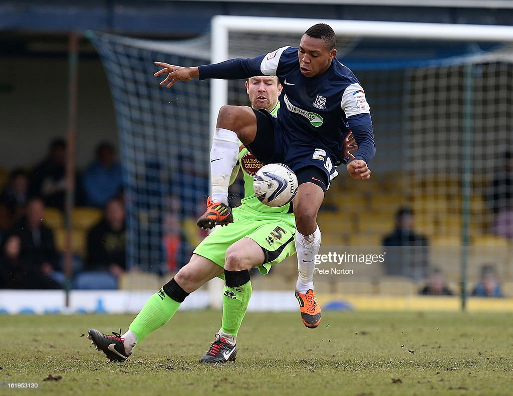 Britt Assombalonga of Southend United attempts to control the ball as Kelvin Langmead of Northampton Town looks on during the npower League Two match between Southend United and Northampton Town at Roots Hall on February 16, 2013 in Southend, England.