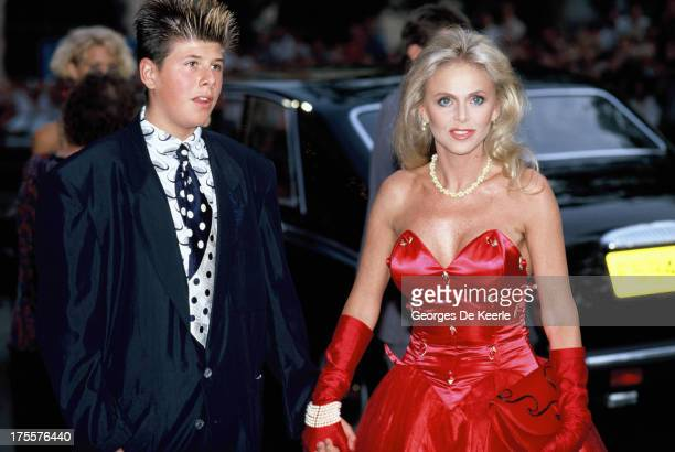 Britt Ekland and her son Nic Adler attend the premiere of the James Bond film 'License to Kill' at the Odeon cinema on June 13 1989 in London England