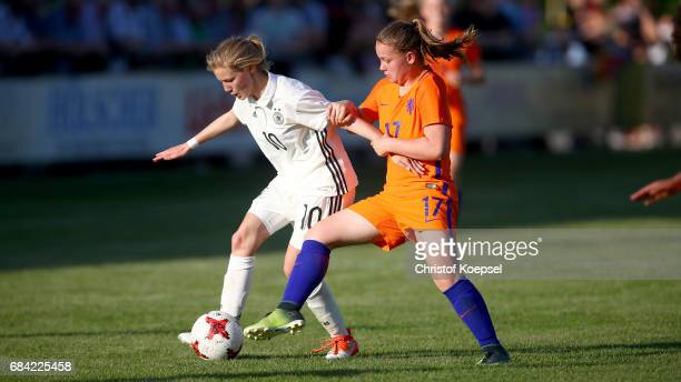 Britt van Rijswijck of the Netherlands challenges Sophie Krall of Germany during the U15 girl's international friendly match between Germany and...