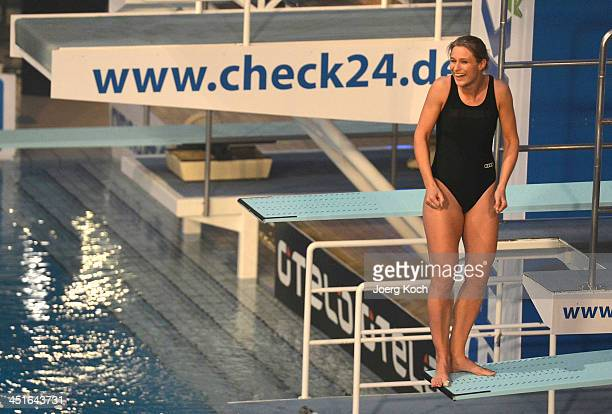 Britta Heidemann jumps during the TV show 'TV Total Turmspringen' from a diving board on November 23 2013 in Munich Germany 'TV Total Turmspringen'...