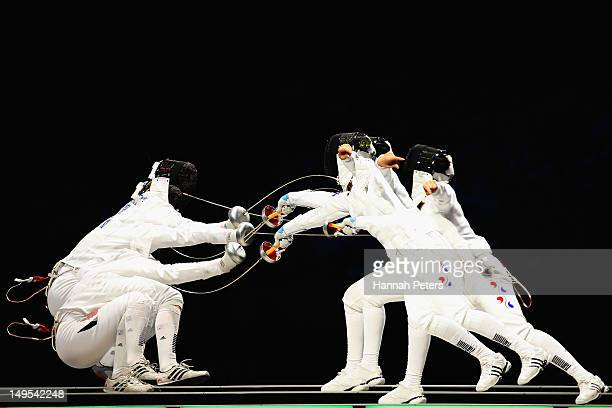 Britta Heidemann of Germany and A Lam Shin of Korea compete in the Women's Epee Individual Fencing Semifinals on Day 3 of the London 2012 Olympic...