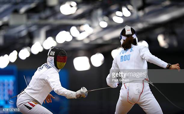 Britta Heidemann of Germany and Simona Pop of Romania compete in the Women's Fencing Indivdual Epee Group D match during day eleven of the Baku 2015...