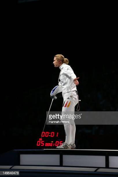 Britta Heidemann of Germany gestures to her coach Manfred Kaspar after an issue with an expired clock was addressed in her bout against A Lam Shin of...
