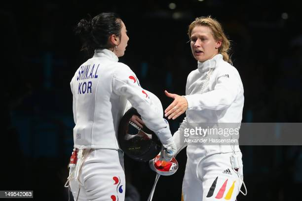 Britta Heidemann of Germany reacts to A Lam Shin of Korea after an issue with an expired clock was addressed in her bout during the Women's Epee...