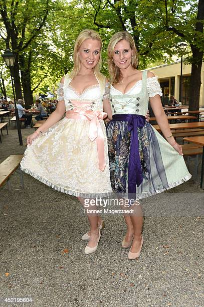 Britta Hofmann and Marlen Neuenschwander attend the Sixt ladies dirndl dinner on July 15 2014 in Munich Germany