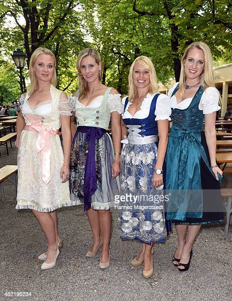 Britta Hofmann Marlen Neuenschwander Sandra Baumgartner and Ruth Hofmann attend the Sixt ladies dirndl dinner on July 15 2014 in Munich Germany