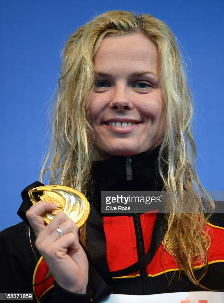 Britta Steffen of Germany poses with her Gold medal after winning the Women's 100m Freestyle Final during day three of the 11th FINA Short Course...