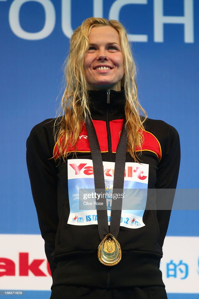 <a gi-track='captionPersonalityLinkClicked' href=/galleries/search?phrase=Britta+Steffen&family=editorial&specificpeople=539792 ng-click='$event.stopPropagation()'>Britta Steffen</a> of Germany poses with her Gold medal after winning the Women's 100m Freestyle Final during day three of the 11th FINA Short Course World Championships at the Sinan Erdem Dome on December 14, 2012 in Istanbul, Turkey.