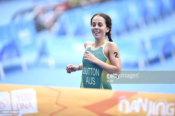 Brittany Dutton of Australia celebrates after winning the Women's Triathlon during day one of the Nanjing 2014 Summer Youth Olympic Games at Xuanwu...