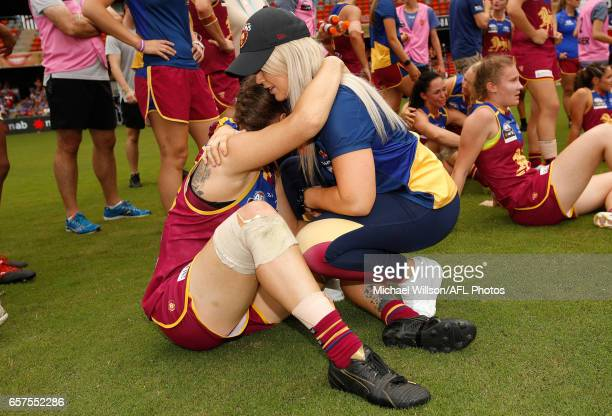 Brittany Gibson of the Lions is consoled during the 2017 AFLW Grand Final match between the Brisbane Lions and the Adelaide Crows at Metricon Stadium...