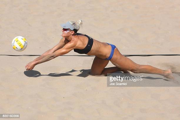 Brittany Hochevar dives for the ball during round 1 of the AVP Manhattan Beach Open Day 2 on August 18 2017 in Manhattan Beach California