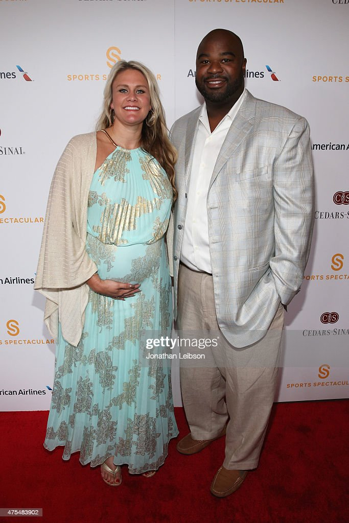 Brittany Jackson and Albert Haynesworth arrive on the red carpet at the 2015 Cedars-Sinai Sports Spectacular at the Hyatt Regency Century Plaza on May 31, 2015 in Century City, California.