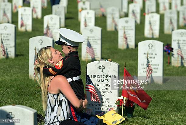 Brittany Jacobs and her son Christian Jacobs of Hertford NC embrace near the grave of Christian's father and Brittany's husband Christopher James...