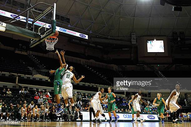 Brittany Kennedy of the Florida Gulf Coast Eagles shoots as Courtney Williams of the South Florida Bulls defends during the game at the Sun Dome on...
