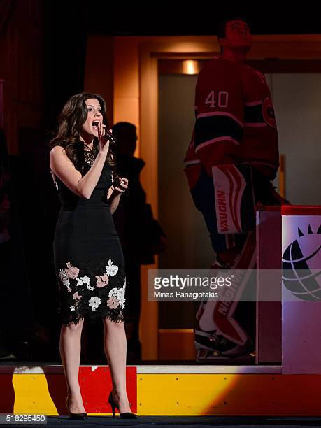 Brittany Kennell Montreal native and contestant on The Voice season 10 sings the national anthems during the pregame ceremony prior to the NHL game...