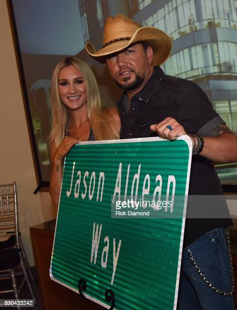Brittany Kerr and Singer/Songwriter Jason Aldean with signage for 'Jason Aldean Way' at The Medical Center Navicent Health's Eversole Auditorium on...