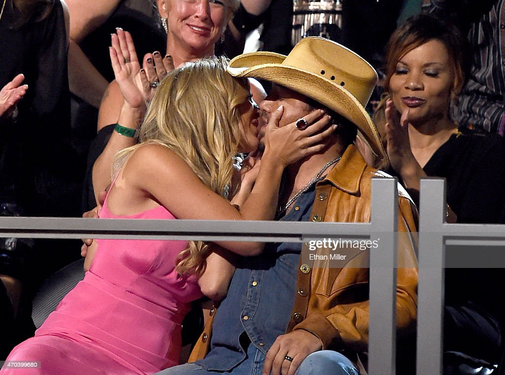 Brittany Kerr kisses recording artist Jason Aldean after he won the award for Male Vocalist of the Year during the 50th Academy of Country Music...