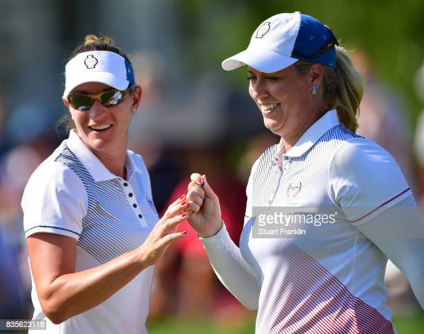 Brittany Lang and Brittany Lincicome celebrate during the second day afternoon fourball matches of The Solheim Cup at Des Moines Golf and Country...