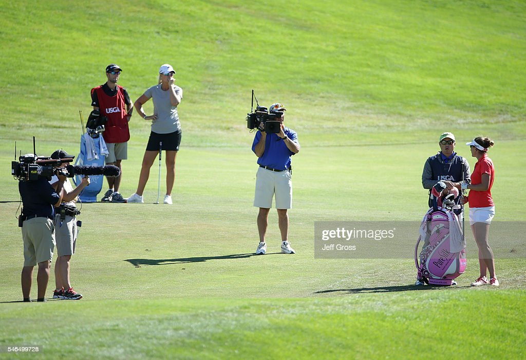 Brittany Lang and her caddie discuss her third shot after being informed by a USGA official that Anna Nordqvist of Sweden was assessed a two stroke penalty for grounding her club in a bunker on the 17th hole during the final round of the U.S. Women's Open at the CordeValle Golf Club on July 10, 2016 in San Martin, California.