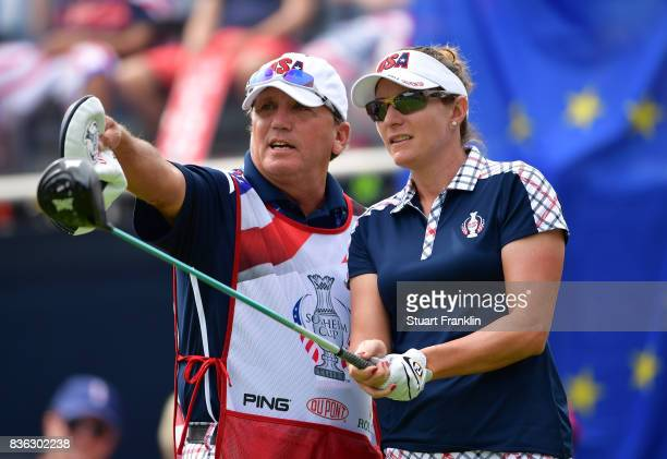 Brittany Lang of Team USA lines up a shot on the 18th hole during the final day singles matches of The Solheim Cup at Des Moines Golf and Country...
