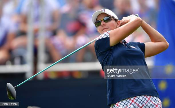 Brittany Lang of Team USA plays a shot on the 18th hole during the final day singles matches of The Solheim Cup at Des Moines Golf and Country Club...