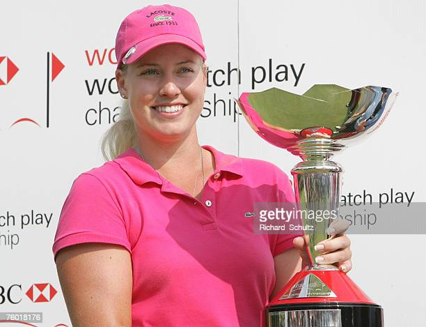 Brittany Lincicome holds up the championship trophy after defeating Juli Inkster 32 during the Finals of the HSBC Women's World Match Play...