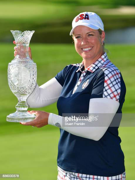 Brittany Lincicome of Team USA holds the Solheim Cup trophy after the final day singles matches of The Solheim Cup at Des Moines Golf and Country...