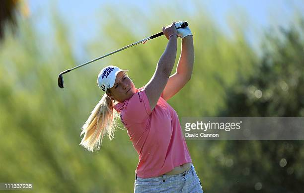 Brittany Lincicome of the USA plays her tee shot at the par 3 7th hole during the first round of the 2011 Kraft Nabisco Championship on the Dinah...